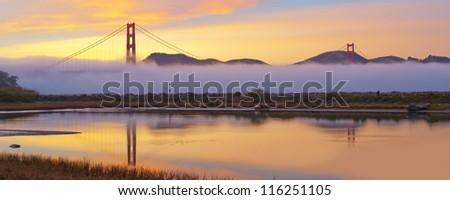 Panorama shot of Golden Gate Bridge at sunset. San Francisco, USA.