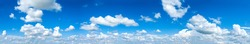 panorama Sunlight with blue sky on dark background.Vivid sky on white cloud.