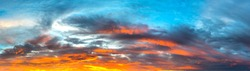Panorama Sunlight with dramatic sky. Cumulus sunset clouds with sun setting down on dark background.Vivid orange cloud sky.