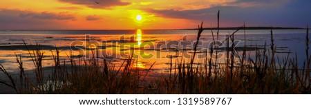 Panorama Sunset at the Wadden Sea #1319589767