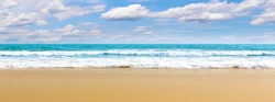 Panorama Tropical beach Natural background for summer vacation. Panorama Photo Turquoise ocean water and blue sky with clouds in sunny day. Beautiful beach with white sand.