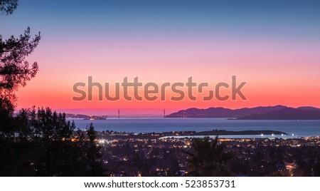 Panorama Twilight view of San Francisco Bay, Golden Gate Bridge, East Bay.