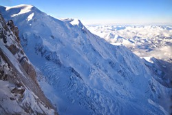 Panorama veiw of the glacier and range of french Alps at the top station at Aiguille du Midi (3 842 meters altitude) in french Alps, Chamonix, Mont Blanc, France