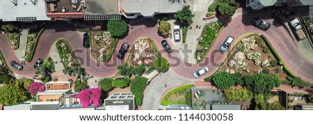 Panorama view aerial Lombard Street, an east–west street in San Francisco, California. Famous for steep, one-block section with eight hairpin turns. Crookedest, steep hills, sharp curves, one-way road