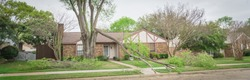 Panorama view fallen tree branch on sidewalk of residential house near Dallas, Texas, US. Dammed matured maple tree blocked at front yard of bungalow home, small branches are cut to clean up