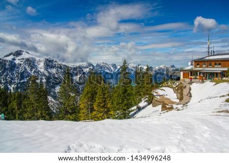 Panorama view from Tegelberg to the Alps landscape. Sunny spring day, snow covered mountains, blue sky, sunshine (Schwangau, Ostallgäu, Allgäu, Allgau, Bavaria, Germany) #1434996248