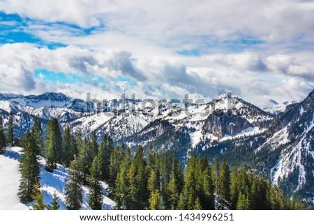 Panorama view from Tegelberg to the Alps landscape. Sunny spring day, snow covered mountains, blue sky, sunshine (Schwangau, Ostallgäu, Allgäu, Allgau, Bavaria, Germany) #1434996251
