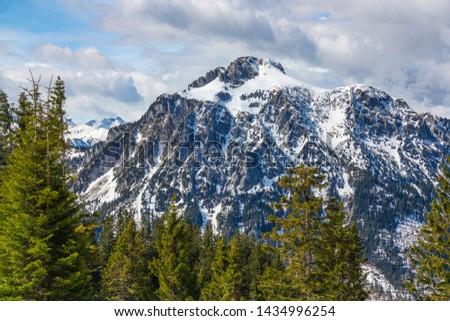 Panorama view from Tegelberg to the Alps landscape. Sunny spring day, snow covered mountains, blue sky, sunshine (Schwangau, Ostallgäu, Allgäu, Allgau, Bavaria, Germany) #1434996254