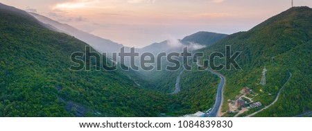 Panorama View from top,Hai Van Pass is one of the most beautiful mountain passes in Vietnam, which is the bridge connecting Danang and Lang Co Bay   #1084839830