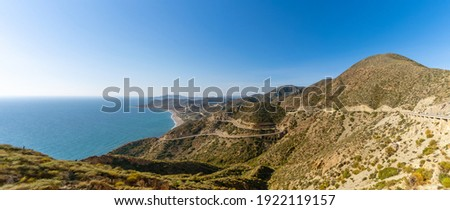 Panorama view of a scenic winding mountain road on the Costa de Almeria in southern Spain Foto stock ©