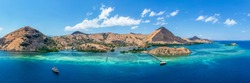 Panorama view of beaches and tourist boat sailing in Flores Island, Indonesia