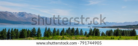Panorama view of Beautiful scene of Mt Cook in summer beside the lake with green tree and blue sky. New Zealand
