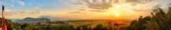 Panorama view of beautiful sunrise over rice field,village and mountain, Beautiful sunrise sky background.Chiang mai, Thailand.