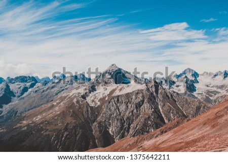 Panorama view of dramatic blue sky and mountains scene in national park Dombay, Caucasus, Russia. Summer landscape and sunny day