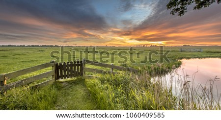 Panorama  view of gate in agricultural landscape of dutch countryside in Groningen Netherlands
