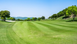 Panorama View of Golf Course with beautiful fairway field. Golf course with a rich green turf beautiful scenery.