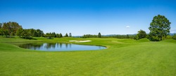 Panorama View of Golf Course with beautiful green field. Golf course with a rich green turf beautiful scenery.