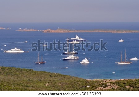 Panorama view of luxury yacths anchored in the wonderful scenery of Costa Smeralda - Sardinia - Italy