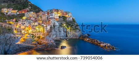Panorama view of Manarola village one of Cinque Terre at night in La Spezia, Italy.