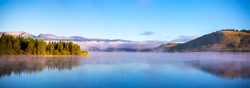 Panorama view of mist and low morning clouds at Hebgen Lake, Montana, USA