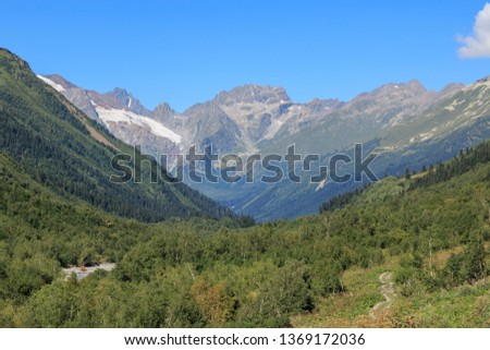 Panorama view of mountains scenes in national park Dombay, Caucasus, Russia, Europe. Summer landscape day and sunny blue sky