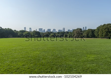 Panorama view of New York City Central Park with Manhattan skyline.