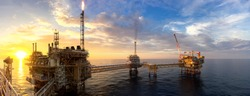 Panorama view of offshore oil and Gas processing platform in sunset time, Concept of exploration and petroleum production industry in the sea.