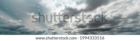 Panorama view of overcast sky. Dramatic gray sky and white clouds before rain in rainy season. Cloudy and moody sky. Storm sky. Cloudscape. Gloomy and moody background. Overcast clouds. Сток-фото ©