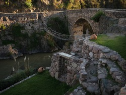 Panorama view of Puente Colonial de Checacupe old historic inca bridge Pitumarca river Palccoyo Cuzco Peru South America