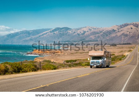 Panorama view of recreational vehicle driving on famous Highway 1 along the beautiful Central Coast of California, Big Sur, USA #1076201930