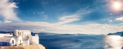 Panorama view of Santorini island in Greece, on a sunny day with beautiful sky. Scenic travel background.