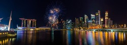 Panorama view of Singapore city skyline and Beautiful fireworks in Marina Bay