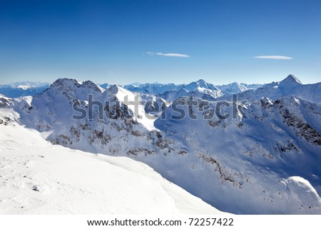 Panorama view of the alps over the snow line with blue sky