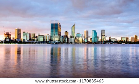 Panorama view of the city of Perth, western Australia, cityscape skyline during golden hour on a cloudy day, with Swan River as foreground #1170835465