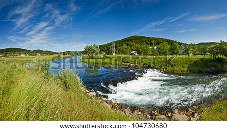 Panorama view of the flow of River Gacka near Oto?ac, Croatia - a place where the original flow of the river is diverted into a channel leading to the hydro power plant