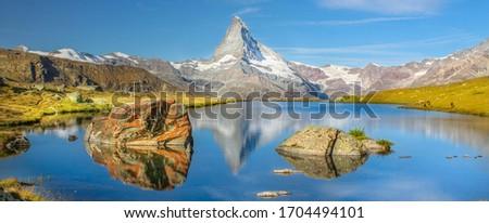 Panorama view of the Matterhorn in Zermatt, Switzerland. The alpine lake Stellisee. Swiss alps summer. Switzerland landmark.
