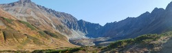 Panorama view of the volcano crater Vachkazhets mountain range. The remains of a large volcano crater attracts tourists with its unusual beauty. Kamchatka Peninsula, Russia.