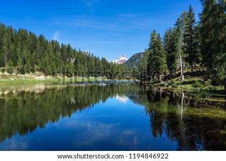 Panorama view of Tre Cime di Lavaredo from lake Adorno, Italy