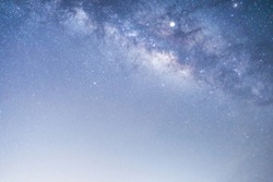 Panorama view of universe space shot of nebula and milky way galaxy with stars on blue night sky. Beautiful scene of Milky Way that contains our Solar System under amazing starry night sky. purple