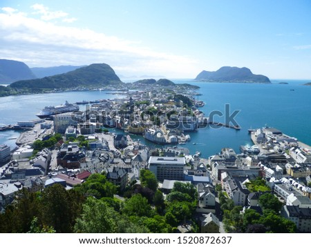 panorama view on beautiful norwegian city Alesund from Fjellstua viewpoint located on top of Aksla mountain in Alesund, Norway, Europe. Popular touristic place for taking panoramic photos by tourists