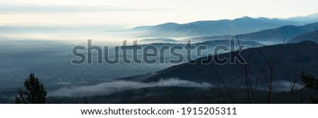 Panorama view on the Vosges massif with mist in winter from Haut-Koenigsbourg castle in France Photo stock ©