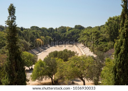 Panorama view over ancient Ruins of the amphitheater and stadium in the Acropolis of Rhodes, Greece. Acropolis dating from the Classical Greek period 3 kilometers from the centre.  #1036930033