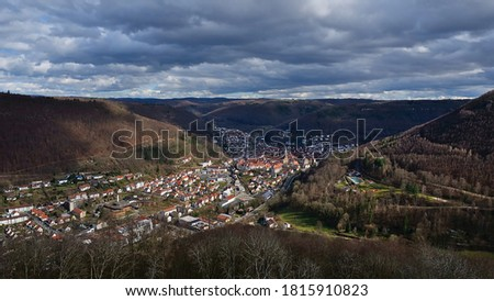 Panorama view over small town and health resort Bad Urach with historic center, part of UNESCO geopark, located in a valley at the edge of Swabian Alb in Baden-Wuerttemberg, southern Germany. Imagine de stoc ©