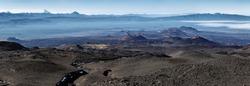 Panorama volcano landscape of Kamchatka Peninsula: series of cinder cones and lava fields of fissure eruptions Plosky Tolbachik Volcano. Russian Far East, Kamchatka, Klyuchevskaya Group of Volcanoes.