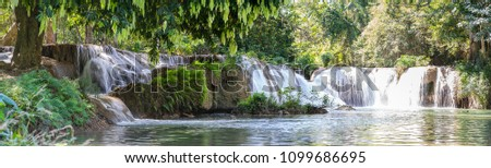 Panorama Waterfall in a forest on the mountain in tropical forest at Waterfall Chet Sao Noi in National park Saraburi province, Thailand #1099686695