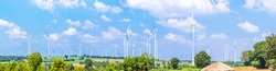 Panorama Wind turbine  generators line the hilltops and Aerial landscape with blue sky