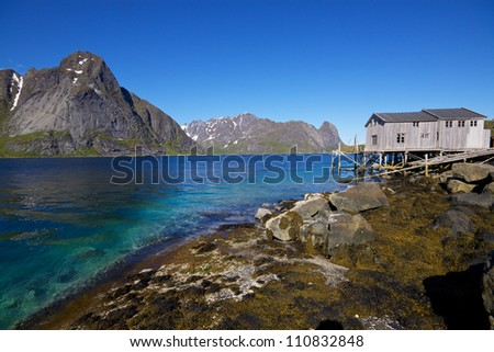 Panorama with old fishing port by the fjord on Lofoten islands in Norway