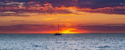 Panorama with sailing ship coloful sunset at IJsselmeer Friesland, Netherlands