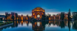 Panorama with the illuminated Palace of Fine Arts during the blue hour at sunset in San Francisco, California photographed in HDR