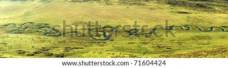Panoramam of curved river on meadow in Altai mountains, Kazakhstan